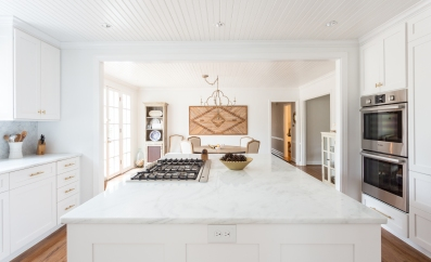 Open wall into dining room, Shadow Storm quartzite countertops, new millwork throughout. Photo courtesy: Julia Steele